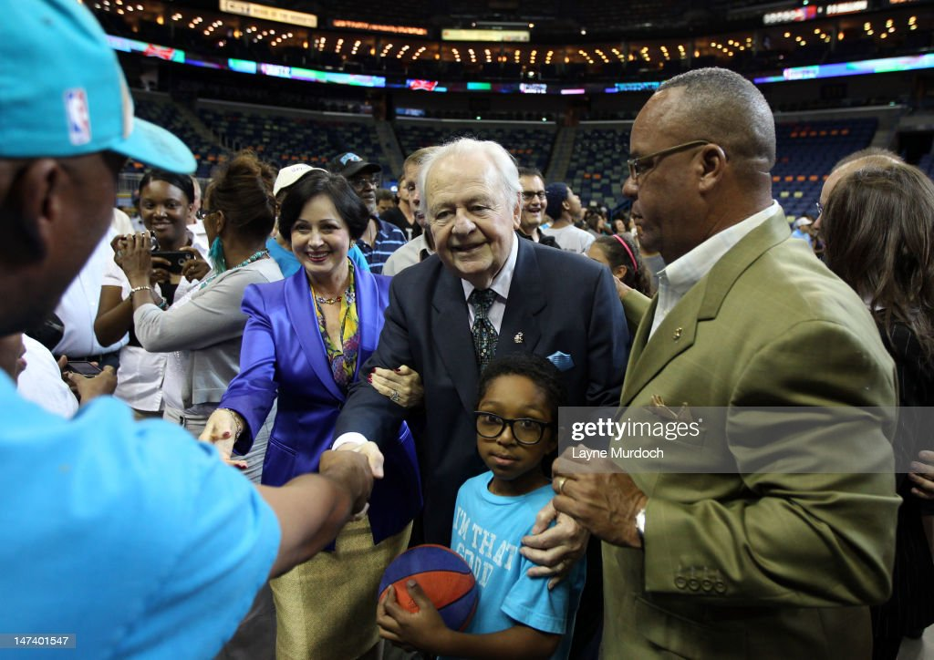 Owner Tom Benson and wife Gayle (L) of the New Orleans Hornets meet with fans after his team selected Anthony Davis of Kentucky with the 1st overall selection in the 2012 NBA draft on JUNE 28, 2012 at the New Orleans Arena in New Orleans, Louisiana.