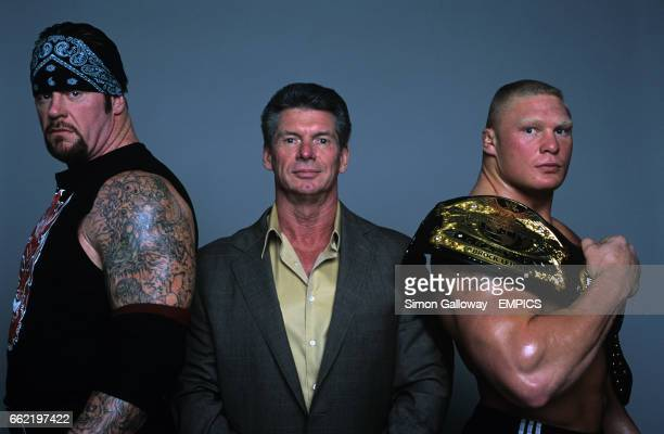 WWE Owner Vincent Kennedy McMahon flanked by superstars The Undertaker and Brock Lesnar