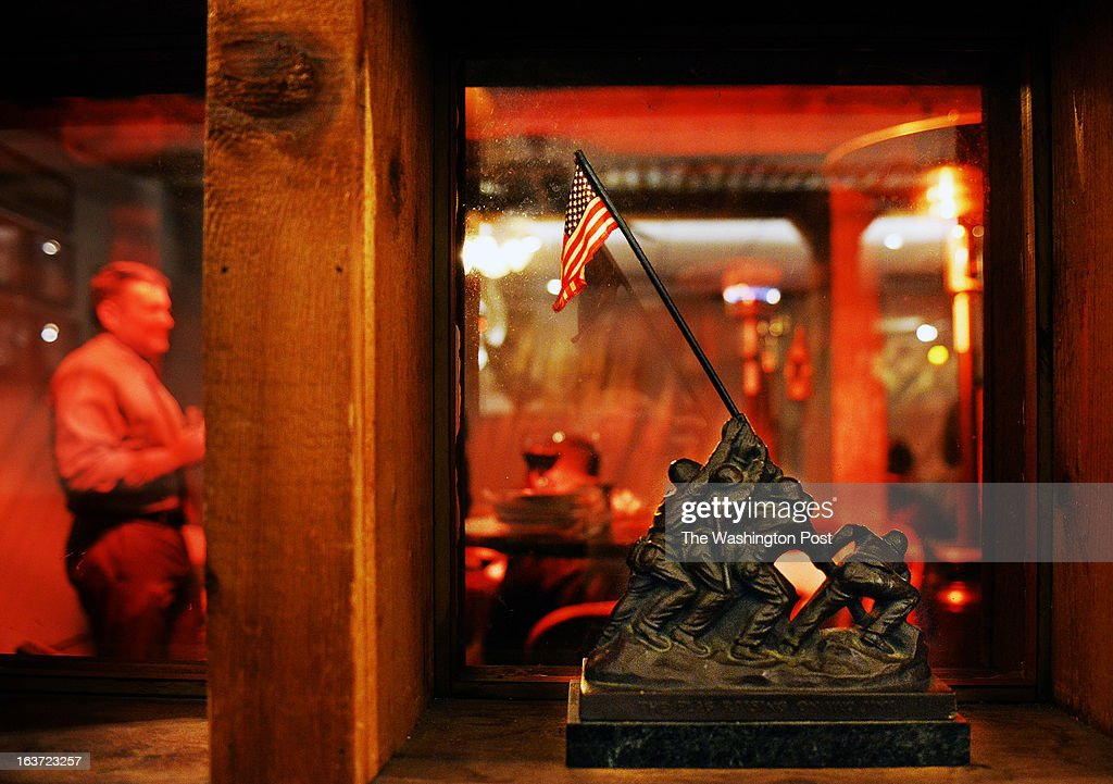 Owners and patrons of the Globe and Laurel, next to the Marine base, face the impending sequestration, on February, 28, 2013 in Quantico, VA. Pictured, a small replica of the famous Marine corps Iwo Jima memorial statue in a window, just one of thousands of marine corps artifacts that decorate the restaurant.