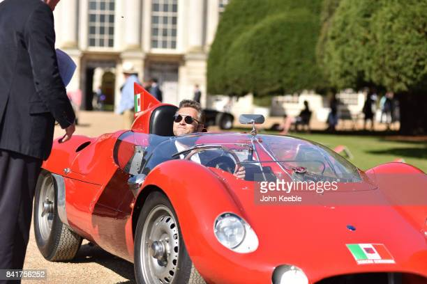 Owners arrive in their vintage cars at the Concours of Elegance at Hampton Court Palace on September 1 2017 in London England The show brings...