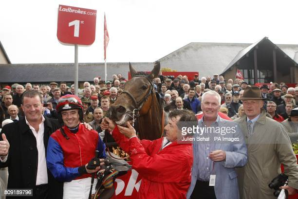 Owners Ger O'Brien and Sean Deane celebrate winning the Ladbrokescom World Series Hurdle with Quevega alongside Jockeyt Ruby Walsh and Trainer Willie...