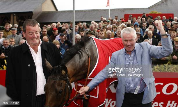 Owners Ger O'Brien and Sean Deane celebrate winning the Ladbrokescom World Series Hurdle with Quevega