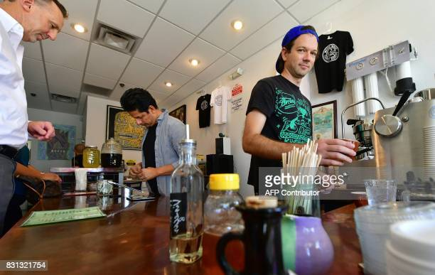 Owners Jackson Defa and Mario Chavarria work at their Weird Wave Coffee Brewers coffee house in the Boyle Heights neighborhood of Los Angeles...