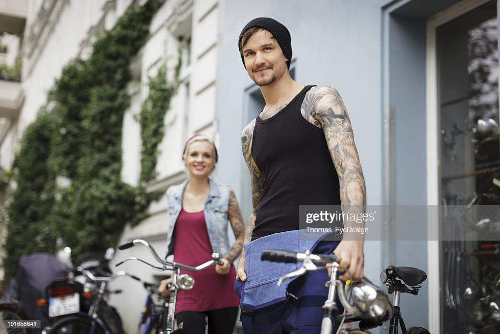 Owners of an Antique Bicycle Store : Stock Photo