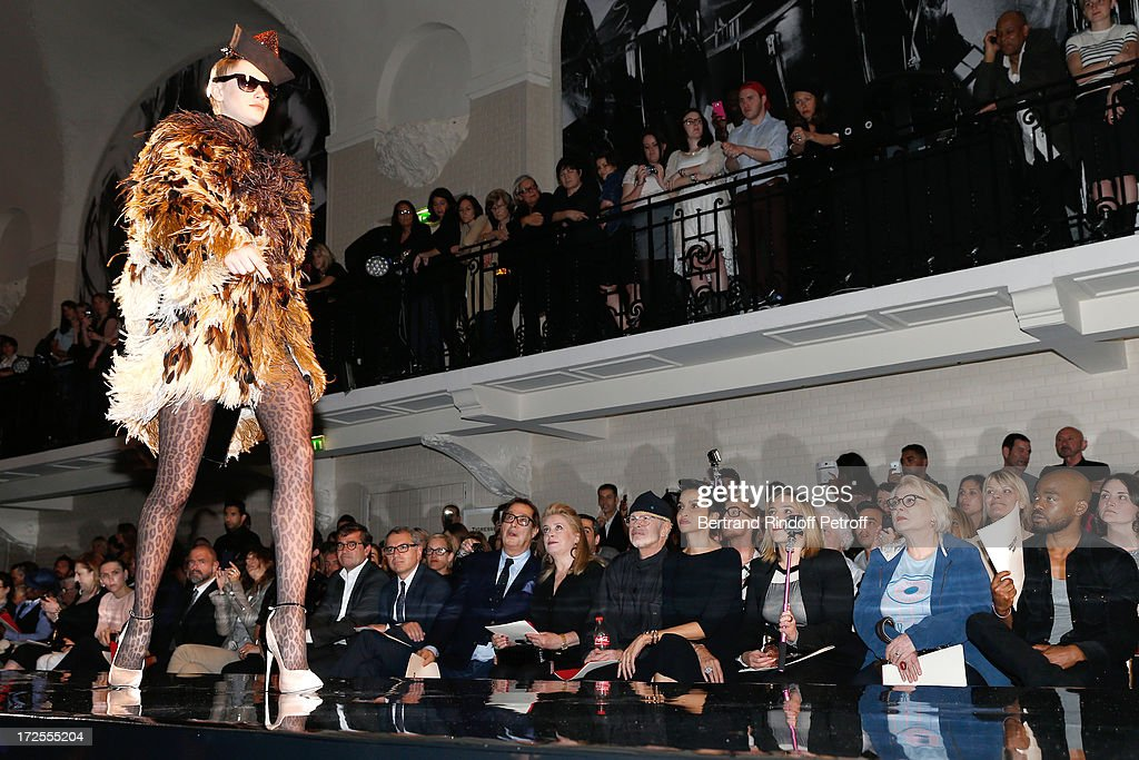 Owners of Gaultier Manuel and Marc Puig, Gilles Dufour, <a gi-track='captionPersonalityLinkClicked' href=/galleries/search?phrase=Catherine+Deneuve&family=editorial&specificpeople=123833 ng-click='$event.stopPropagation()'>Catherine Deneuve</a>, <a gi-track='captionPersonalityLinkClicked' href=/galleries/search?phrase=Jean-Paul+Goude&family=editorial&specificpeople=2594306 ng-click='$event.stopPropagation()'>Jean-Paul Goude</a>, <a gi-track='captionPersonalityLinkClicked' href=/galleries/search?phrase=Farida+Khelfa&family=editorial&specificpeople=4866090 ng-click='$event.stopPropagation()'>Farida Khelfa</a> and <a gi-track='captionPersonalityLinkClicked' href=/galleries/search?phrase=Josiane+Balasko&family=editorial&specificpeople=768143 ng-click='$event.stopPropagation()'>Josiane Balasko</a> near her daughter <a gi-track='captionPersonalityLinkClicked' href=/galleries/search?phrase=Marilou+Berry&family=editorial&specificpeople=672535 ng-click='$event.stopPropagation()'>Marilou Berry</a> and her son Rudy Berry attend the Jean Paul Gaultier show as part of Paris Fashion Week Haute-Couture Fall/Winter 2013-2014 at 325 Rue Saint Martin on July 3, 2013 in Paris, France.