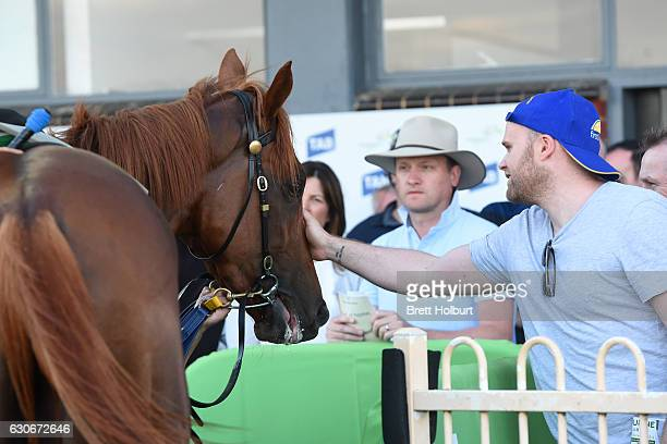 Owners of Linguist after winning Procon Developments Maiden Plate at Cranbourne Racecourse on December 30 2016 in Cranbourne Australia