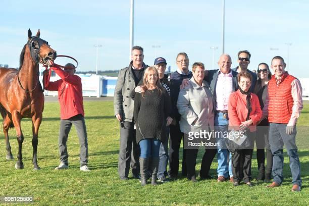 Owners of Miss Clooney after winning the IGA Liquor BM70 Handicap at Racingcom Park Synthetic Racecourse on June 20 2017 in Pakenham Australia