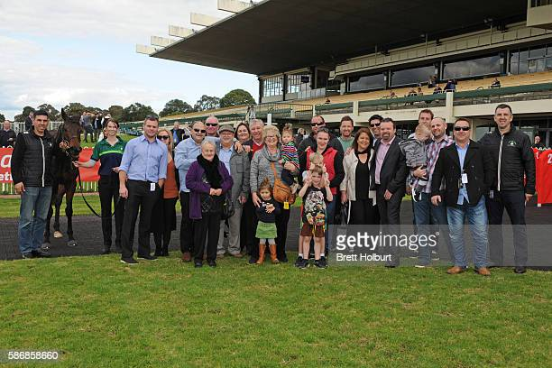Owners of Moss 'n' Dale after winning The Grand Hotel Frankston Hcp at Ladbrokes Park Lakeside Racecourse on August 07 2016 in Springvale Australia
