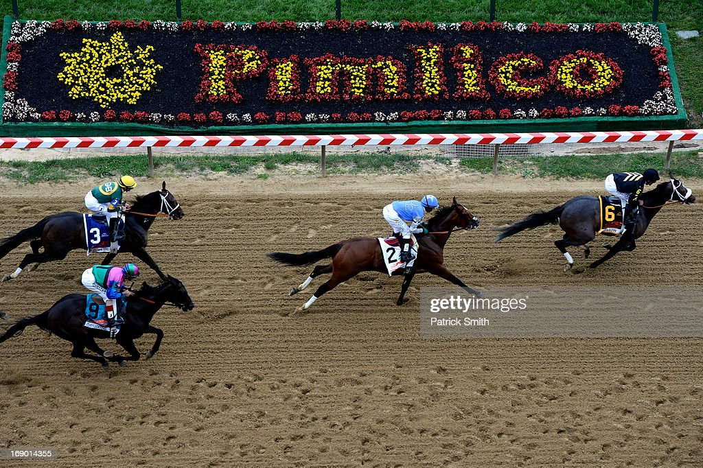 Oxbow ridden by Gary Stevens leads the field ahead of Glodencents ridden by Kevin Krigger to the finish line to win the 138th running of the...