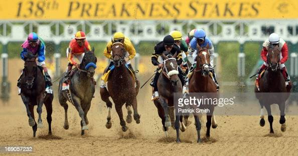 Oxbow ridden by Gary Stevens leads the field at the start of the race to win the 138th running of the Preakness Stakes at Pimlico Race Course on May...