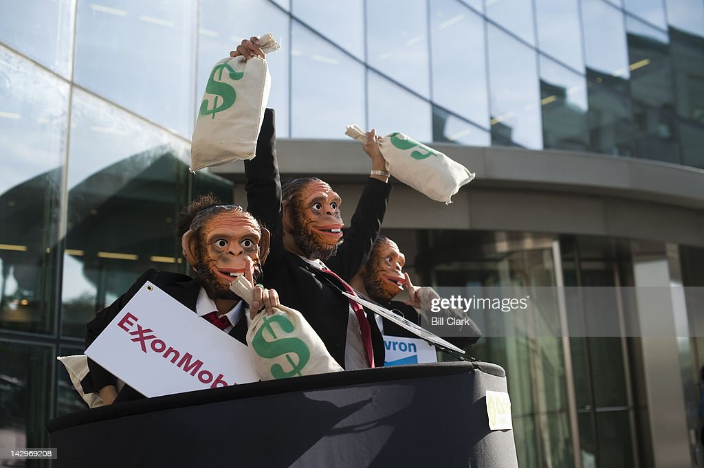 Oxfam America holds a rally in front of the SEC building on Monday, April 16, 2012, with activists dressed in suits and wearing monkey masks, to call on the Securities and Exchange Commission to set a date for issuing final rules for the oil, gas and mining transparency provision of the Dodd-Frank Act, coinciding with the one-year anniversary on April 17 of when the regulatory agency was required by Congress to issue final rules.