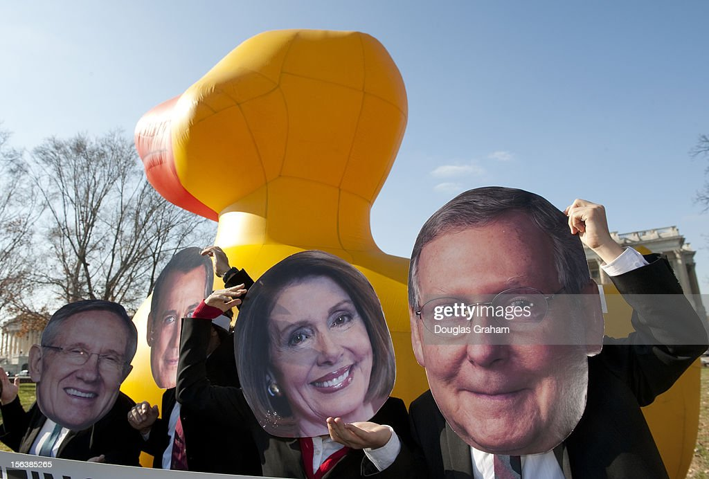 Oxfam America was protesting the Congress with activists dressed as members of the leadership of the Senate and House posing with a giant inflatable duck to draw attention to the question of whether a 'lame duck' Congress will support foreign aid on November 14, 2012.