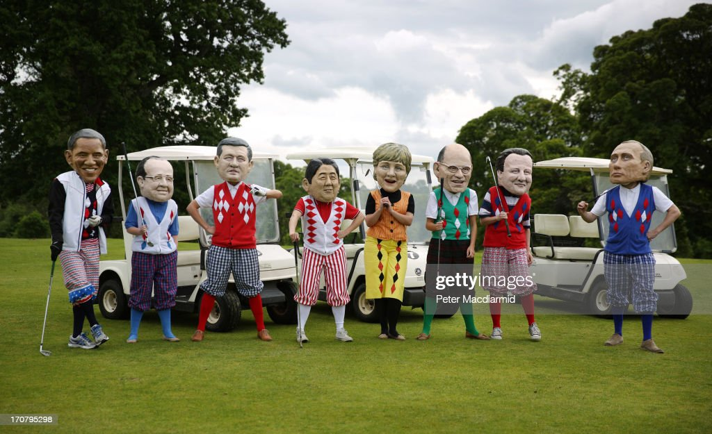 Oxfam volunteers wearing caricature heads of the G8 leaders pose in golf clothing as part of their End Hunger campaign photocall on June 18, 2013 in Enniskillen, Northern Ireland. The G8 summit, hosted by UK Prime Minister David Cameron, is expected to discuss tax avoidance issues on it's final day.