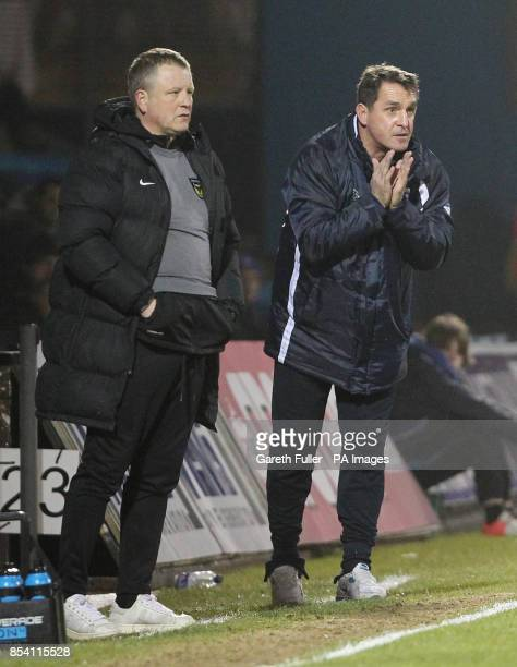 Oxford manager Chris Wilder and Gillingham manager Martin Allen watch their teams during the npower League Two match at the Priestfield Stadium...