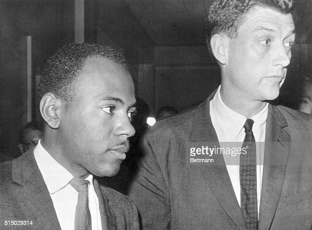 Negro James Meredith and Assistant Attorney General John Doar leave the Registrar's office at the University of Mississippi after Meredith enrolled