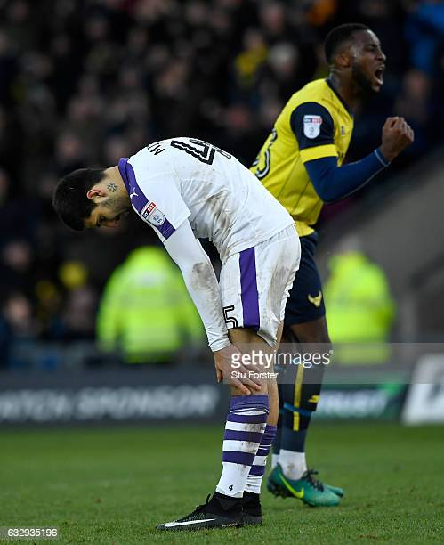 Oxford player Chey Dunkley celebrates as Aleksander Mitrovic of Newcastle United reacts after missing his penalty during The Emirates FA Cup Fourth...