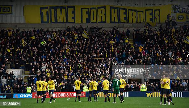 Oxford players and fans celebrate victory after The Emirates FA Cup Third Round match between Oxford United and Swansea City at Kassam Stadium on...