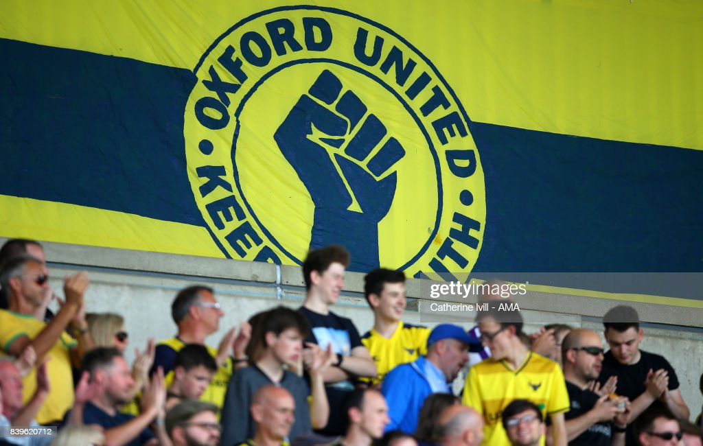 Oxford United banner / flag behind the fans during the Sky Bet League One match between Oxford United and Shrewsbury Town at Kassam Stadium on August 26, 2017 in Oxford, England.