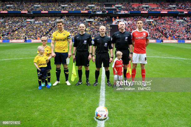Oxford United captain Johnny Mullins and Barnsley captain Conor Hourihane pose for a photograph with the mascots and officials