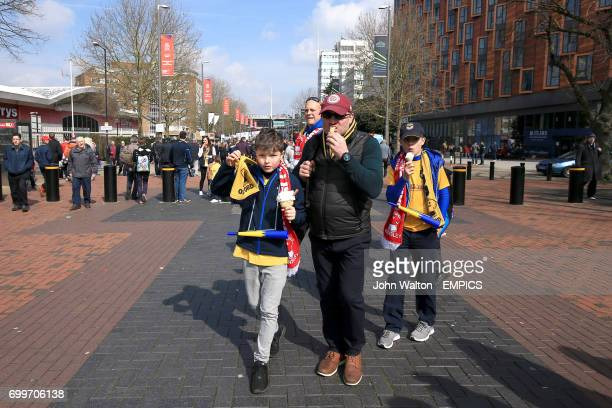 Oxford United fans enjoy an icecream on Wembley Way before the game