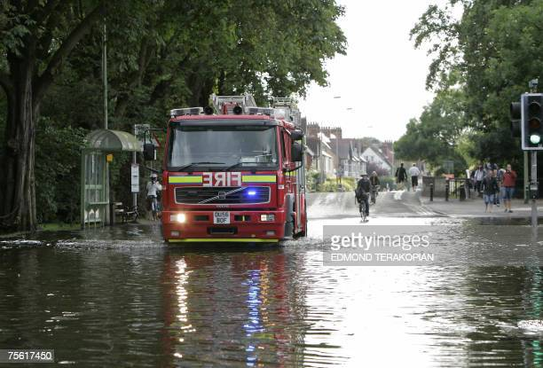 A Fire Engine makes its way through flooded Botley Road in Oxford 24 July 2007 The River Thames has burst its banks in Oxford due to the heavy rain...
