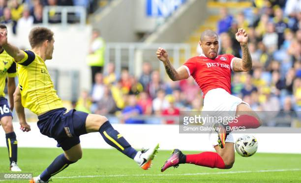 Oxford United's Charlie Raglan and Charlton Athletic's Josh Magennis in action
