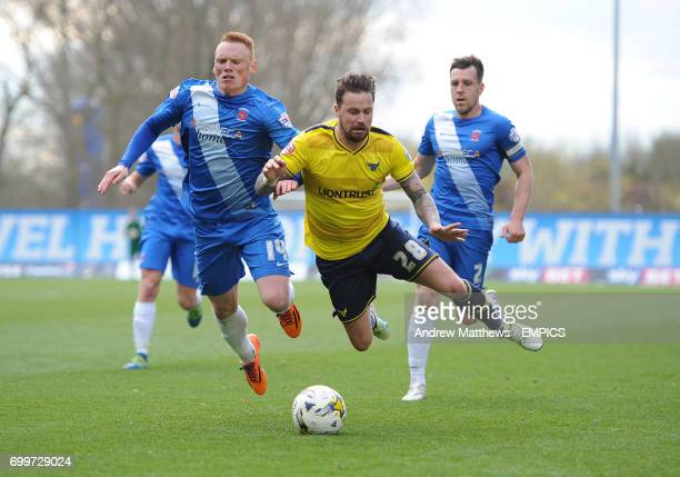 Oxford United's Chris Maguire is tackled by Hartlepool United's Michael Woods