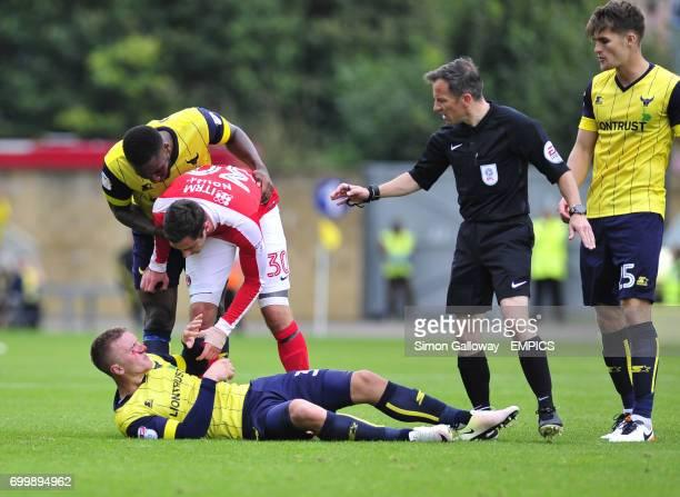 Oxford United's Joe Skarz and Charlton Athletic's Lee Novak in action