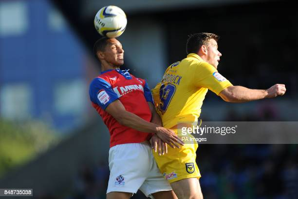 Oxford United's Tom Craddock and Gillingham's Lewis Montrose battle for the ball during the npower Football League Two match at the Kassam Stadium...