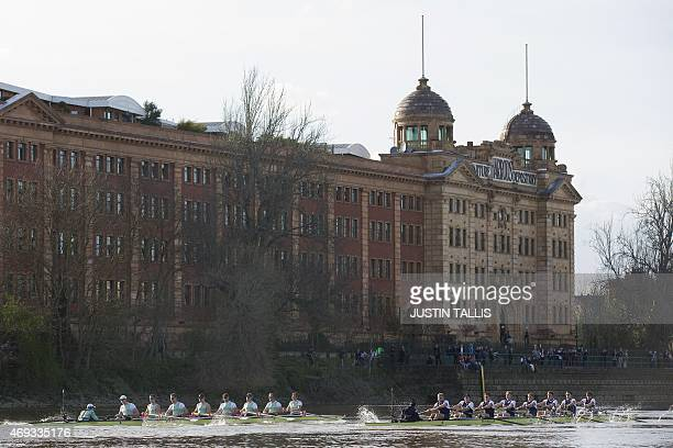 Oxford University and Cambridge row past the Harrods depository building during the boat race between Oxford university and Cambridge university on...