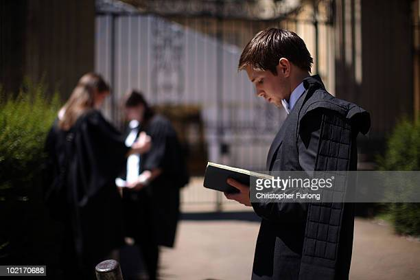 Oxford University students take in some last minute revision before entering the Exam Schools building to take examinations on June 17 2010 in Oxford...