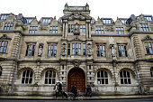 Oxford University's Oriel College with a statue of Cecil Rhodes on the second floor above the door as students take to the streets to protest about...