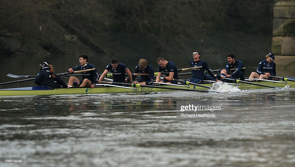 Oxford's 'Hurricane' crew colapse with exhustion after crossing the finish line during the trial 8's for The BNY Melon University Boat Race on The River Thames on December 13, 2012 in London, England.