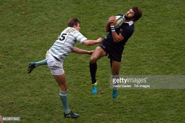 Oxford's Matt Janney takes a high ball under pressure from Cambridge's Toby May during the 2013 Varsity match at Twickenham London