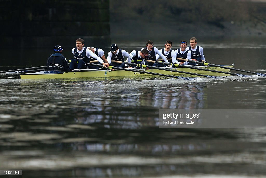 Oxford's 'Spitfire' crew colapse with exhustion after crossing the finish line during the trial 8's for The BNY Melon University Boat Race on The River Thames on December 13, 2012 in London, England.