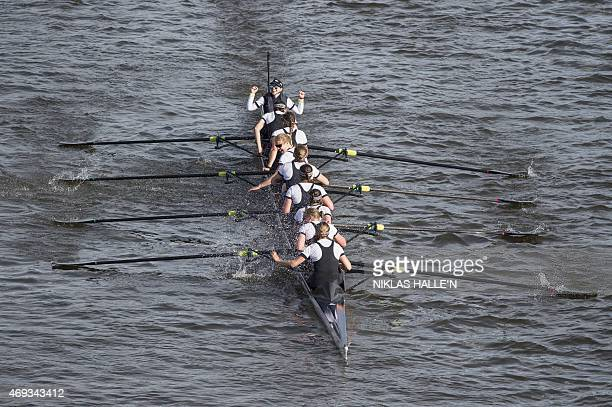 Oxford's women's crew celebrate after beating Cambridge during the boat race between Oxford university and Cambridge university on April 11 2015 in...