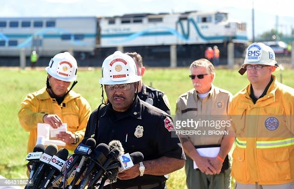Oxnard Fire Department Chief James Williams briefs the media beside railway tracks where a truck was hit by a Los Angelesbound Metrolink train during...