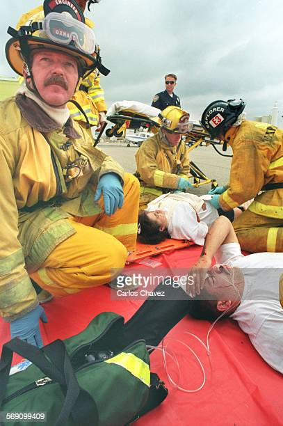 Oxnard Fireman Darwin Base waits for medical personal to tend to victim of a plane crash duiring a disaster drill at the Oxnard Airport