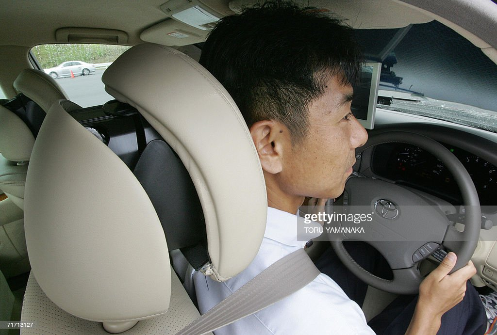Part of a headrest comes out to protect a driver's head in case of a risk of collision from behind when driving a car equipped with the...