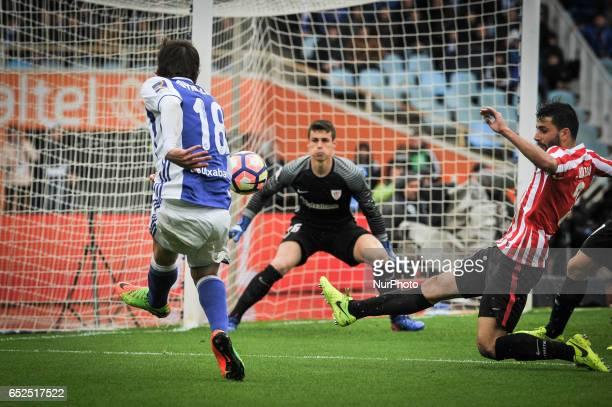 Oyarzabal kick the ball Eneko Boveda and Kepa Arrizabalaga of Athletic Club during the Spanish league football match between Real Sociedad and...