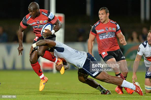 Oyonnax' French wing Dug Codjo is tackled during the French Top 14 rugby union match between Agen and Oyonnax on June 5 2016 at the Armandie stadium...