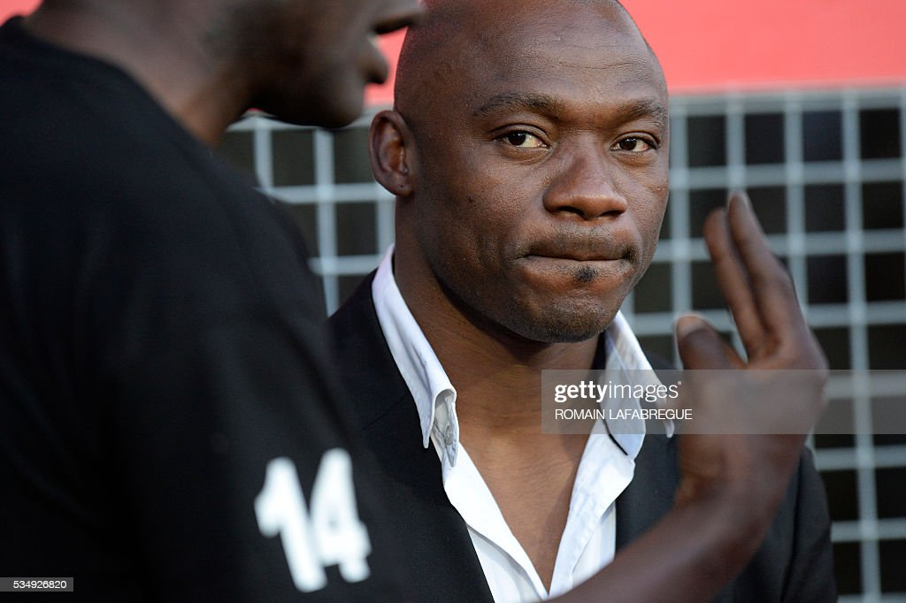 Oyonnax Ivorian wing Silvere Tian looks on before the start of the French Top 14 rugby union match between Oyonnax (USO) and Castres (CO) on May 28, 2016 at the Charles-Mathon stadium in Oyonnax, central eastern France. / AFP / ROMAIN