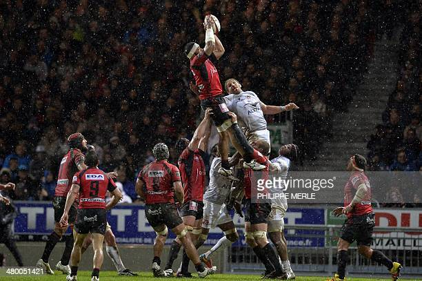 Oyonnax's lock Wiliami Maafu grabs the ball in a lineout during the French Top 14 rugby union match between Oyonnax vs Montpellier on March 22 2014...