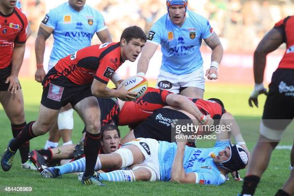 Oyonnax's scrumhalf Fabien Cibray passes the ball during the French Top 14 rugby union match between Perpignan and Oyonnax at the AimeGiral stadium...