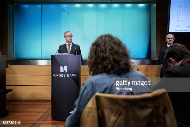 Oystein Olsen governor of Norway's central bank also known as Norges Bank left pauses as he speaks during an interest rates news conference in Oslo...