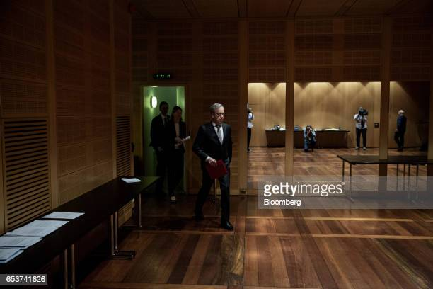 Oystein Olsen governor of Norway's central bank also known as Norges Bank arrives for an interest rates news conference in Oslo Norway on Thursday...