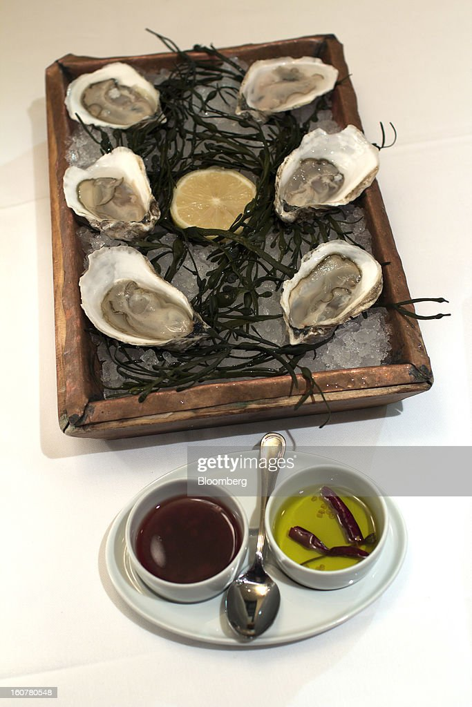Oysters are served over a bed of ice at Esca's in New York, U.S., on Jan. 14, 2013. Upon serving, a waiter will shave horseradish onto the dish. Photographer: Philip Lewis/Bloomberg via Getty Images