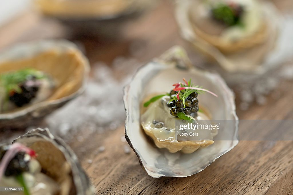 Oysters on half shell canapes stock photo getty images for Canape shells