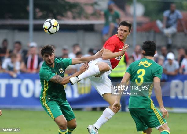 Ozan Tufan of Fenerbahce and Guido Carrillo of Monaco vie for the ball during friendly game between Fenerbahce and Monaco at Chailly Stadium in...