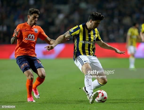 Ozan Tufan of Fenerbahce in action against Uilson De Souza Paula Junior of Medipol Basaksehir during the Ziraat Turkish Cup semi final soccer match...